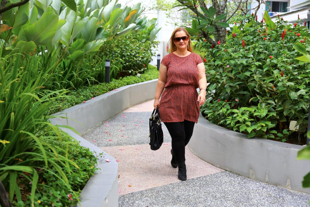 Plus size thrifting in Singapore - the animal print tunic with black jeans and black boots